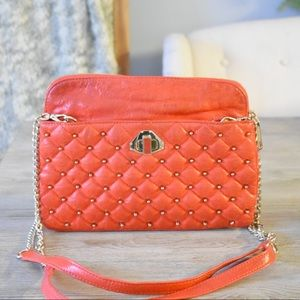 Orange studded Rebecca Minkoff shoulder bag